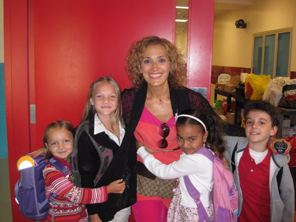 principal posing with students