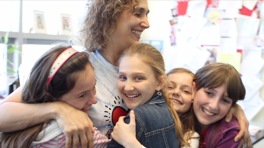 principal hugging students
