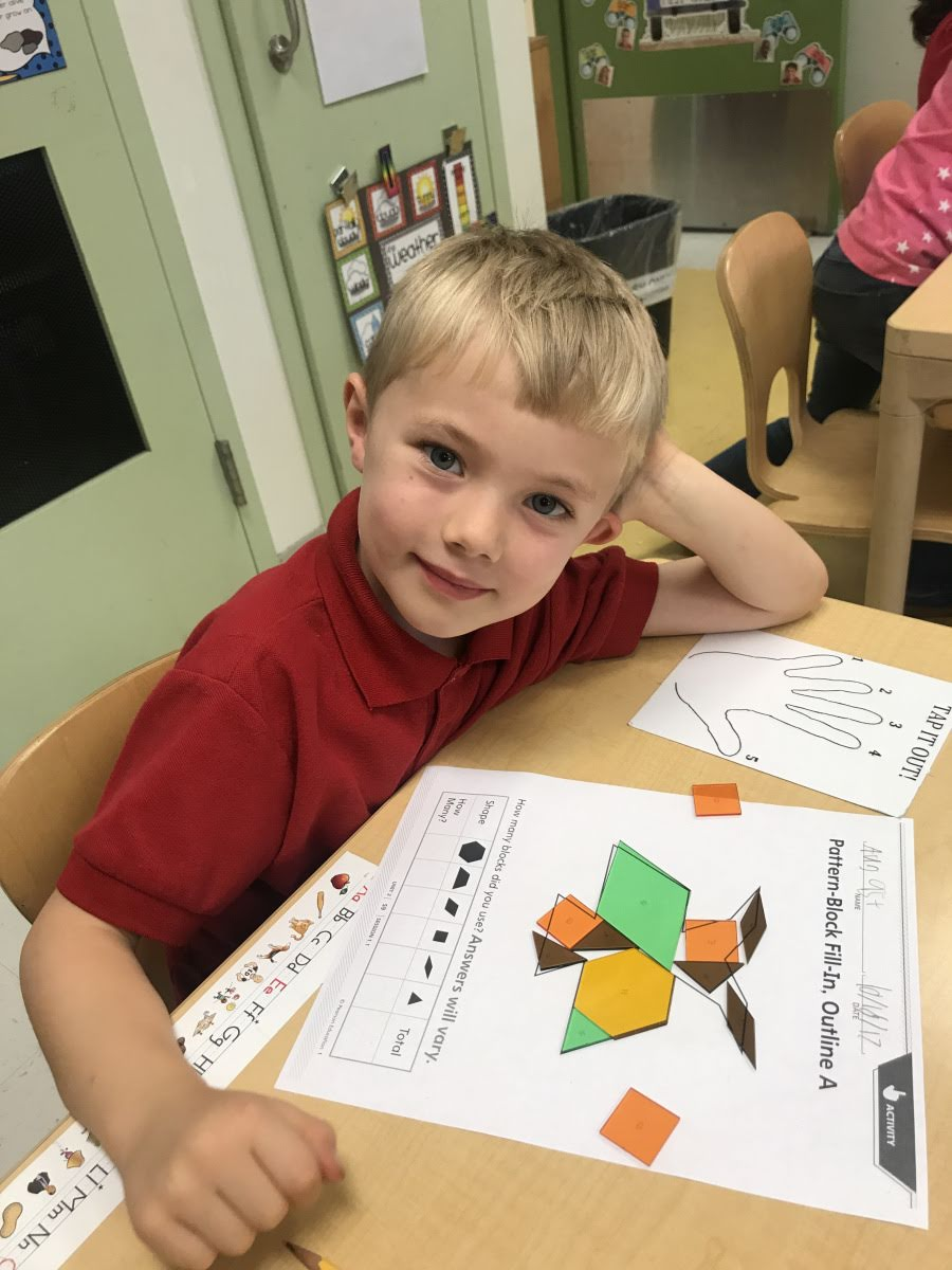 student using pattern blocks
