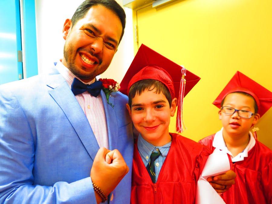 teacher and student celebrating graduation