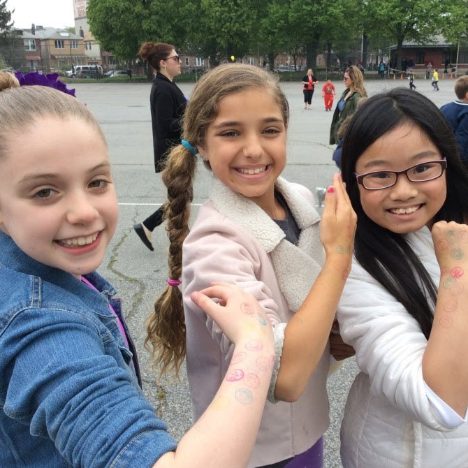 students making muscles in the park