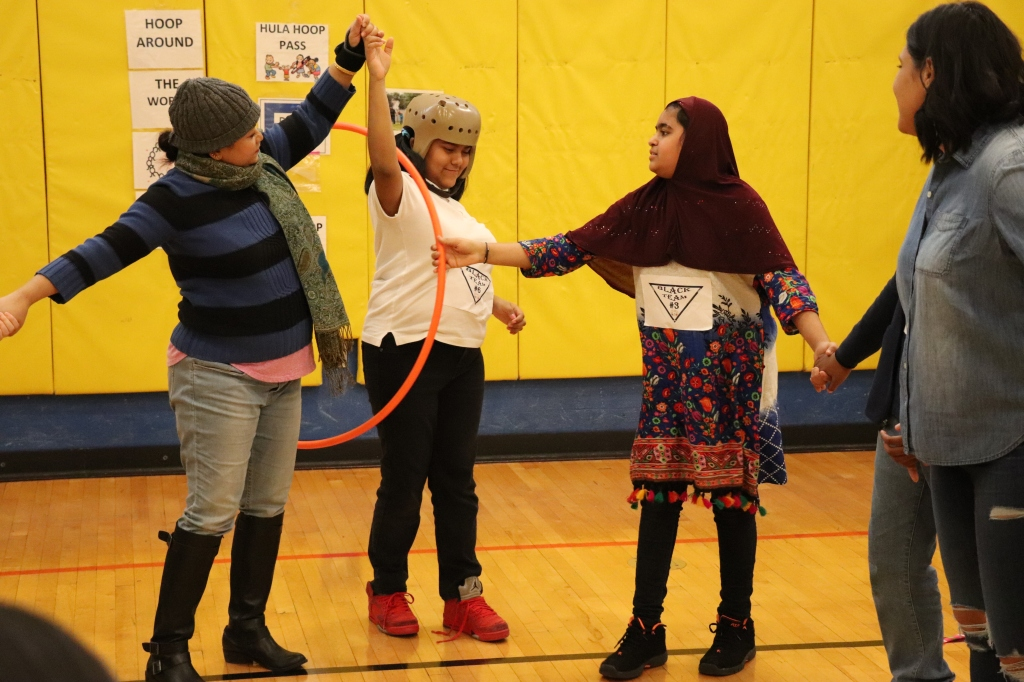 students playing with hula hoop